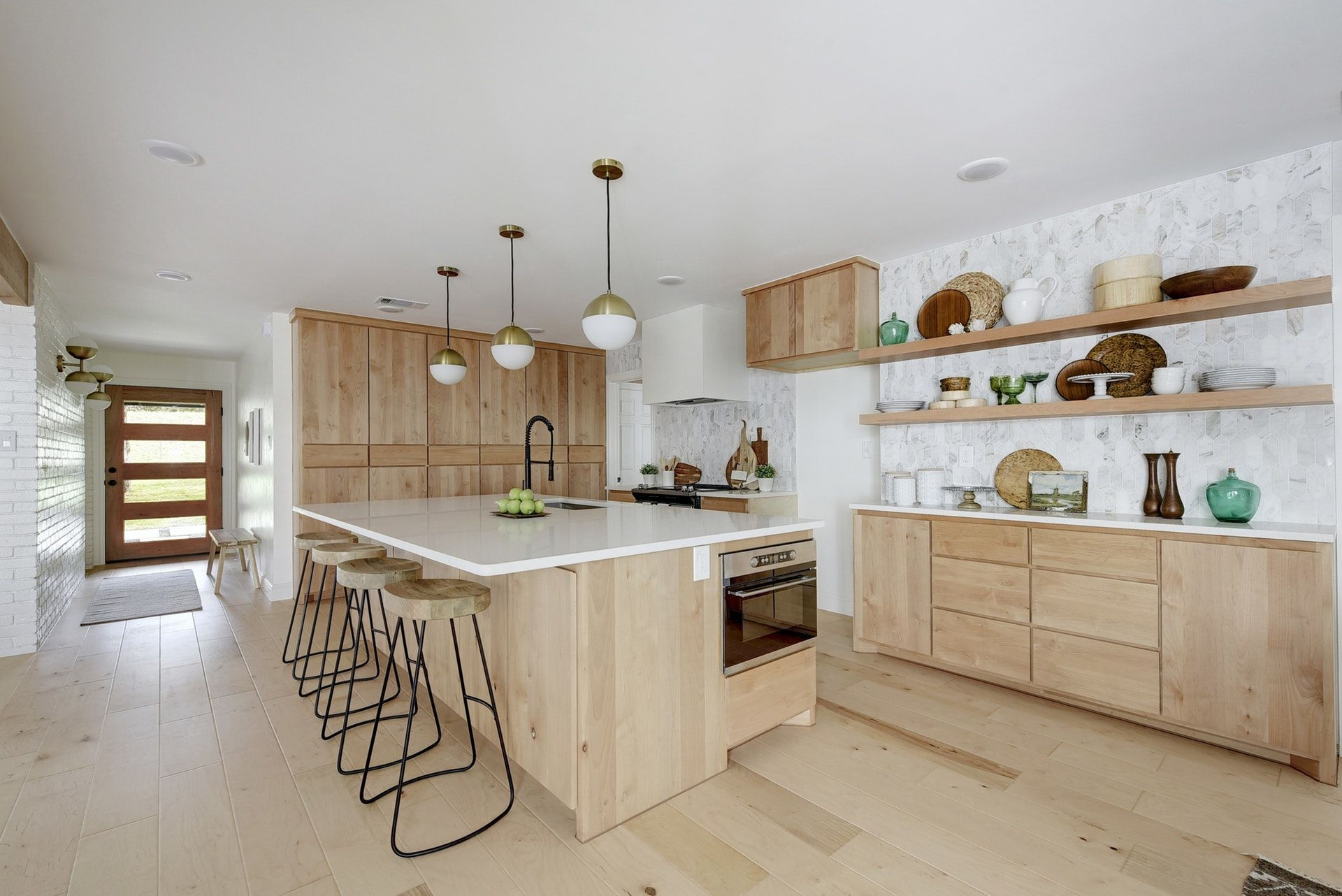 Open Kitchen With Flat Front Natural Alder Wood Cabinets Light Wood Floors Globe Pendants With Light Wood Kitchens Natural Wood Kitchen Wood Kitchen Cabinets