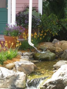 Rain garden route downspouts to dry creek bed as an