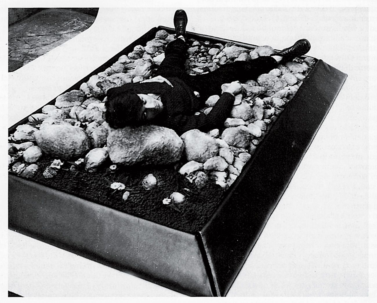 "Piero Gilardo: Stone-Bed. Gilberto Zorio lying on ""Stones-bed"" in Gilardi's Turin studio, 1967.  Polyurethane foam, 78 3/4 by 39 1/4 by 11 3/4 inches. Photo courtesy the artist."