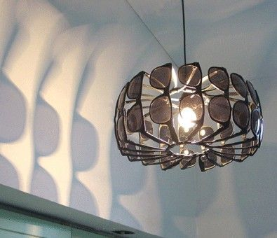 Light fixture made of sunglasses -- Although it's an idea that will never  fit with