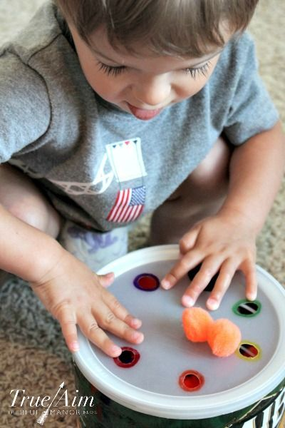 Preschool activity: Fine motor pom pom machine - Use to teach color recognition and basic math equations!