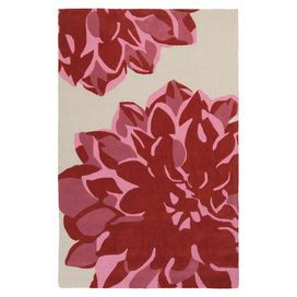 """Stylishly anchor your living room or master suite with this artfully hand-tufted rug, showcasing a blooming floral motif in red and neutral hues.  Product: RugConstruction Material: 100% PolyesterColor: Red and neutralFeatures:  Hand-tuftedPlush pilePile Height: 0.46"""" Note: Please be aware that actual colors may vary from those shown on your screen. Accent rugs may also not show the entire pattern that the corresponding area rugs have.Cleaning and Care: Vacuum regularly with non-beater ..."""