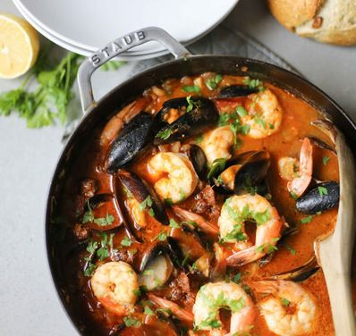 This summery seafood stew highlights the best of  summer produce --vine-ripened tomatoes and fresh fennel bulb. The technique of sautéing  tomato paste adds incredible flavor and depth, while lemon and parsley add a welcome brightness. The whole thing can be made in 30 minutes flat!