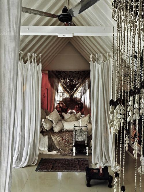 I love the structural shape of the room and the use of cheesecloth fabric around the bed.