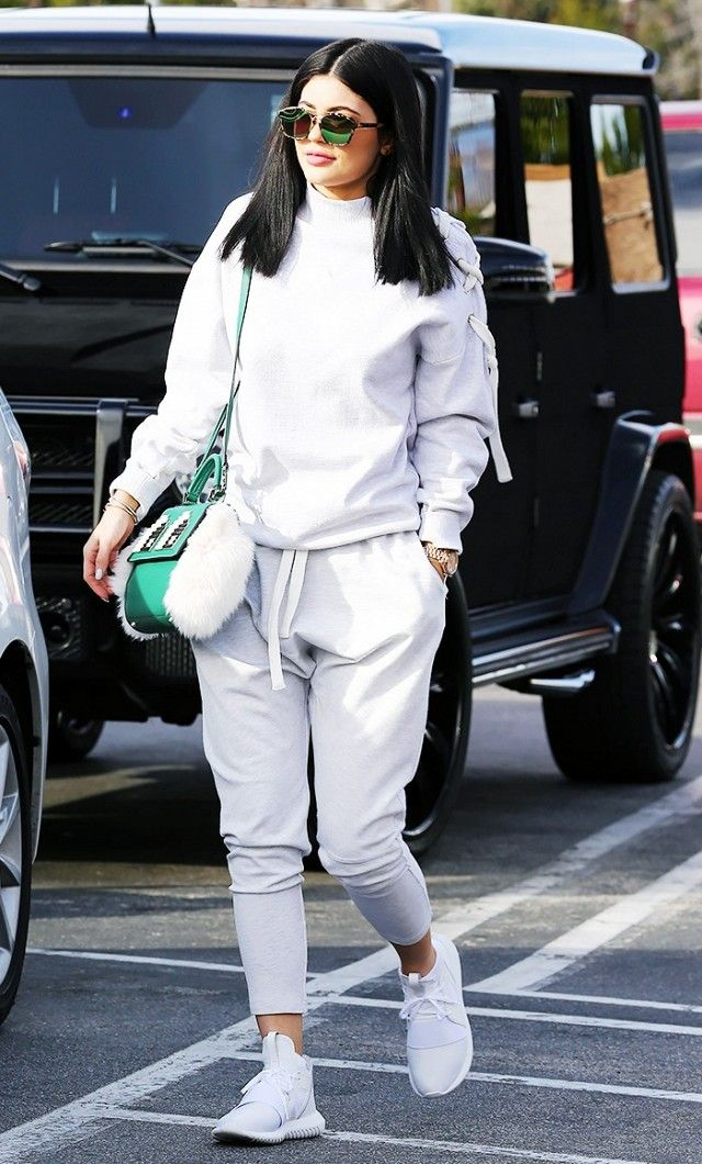 adbc3168a Kylie Jenner wears a gray sweatshirt with lace-up detailing, gray sweats,  white sneakers, Les Petits Joueurs top-handle bag, and Dior sunglasses