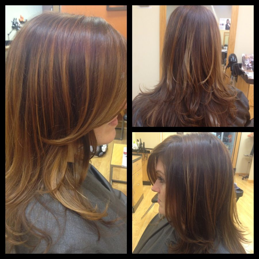 Dark golden brown with caramel highlights, long layers ...
