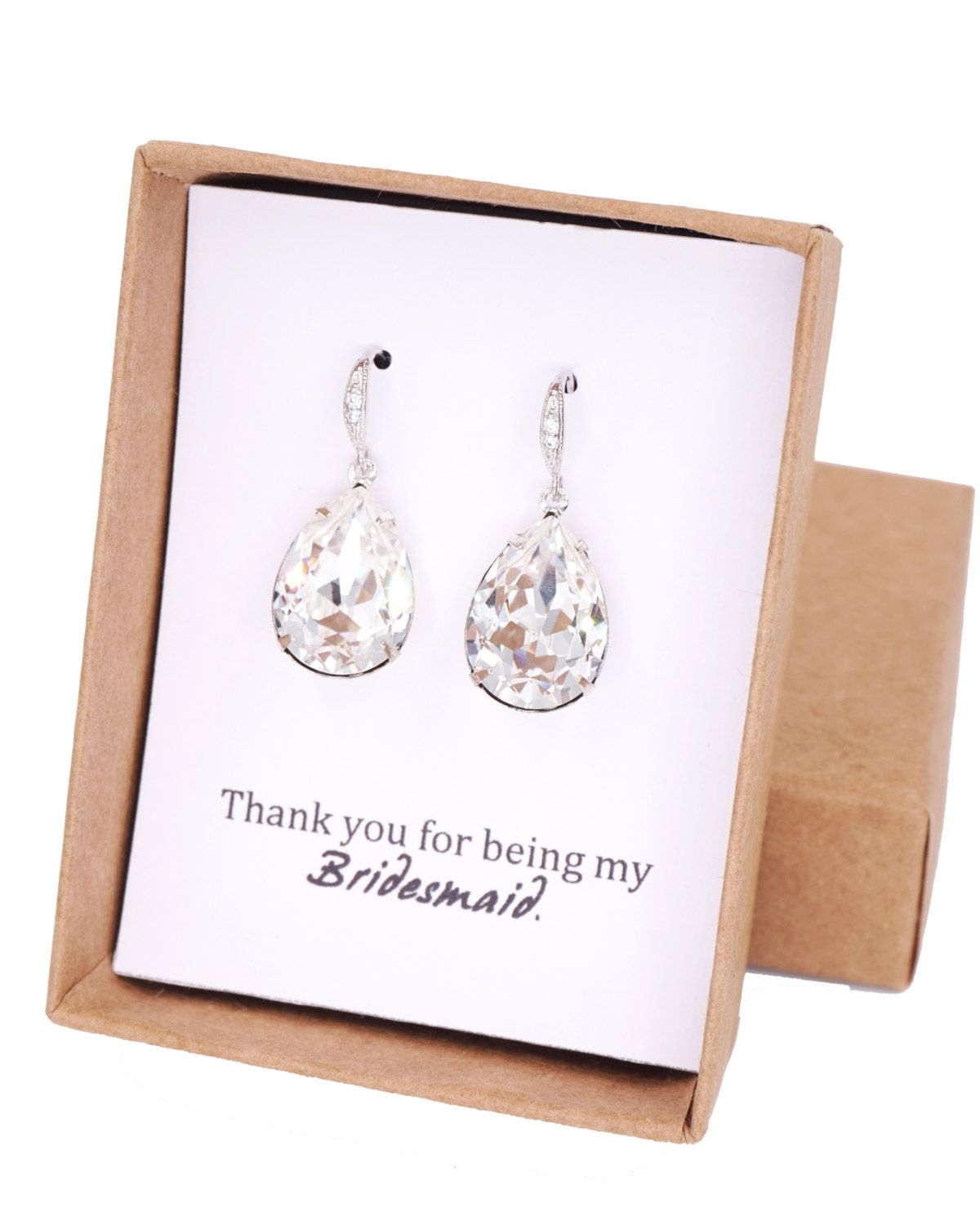 Clear Swarovski Crystal Teardrop (13mm x 18 mm) in sterling silver plated closed back stone settings. Cubic zirconia Teardrop earrings, Luster rhodium plated.  Nickel Free.  ✦ Earrings Length: 1.2 inch  CUSTOM NOTE IN BOX: Please let me know the following at checkout: - Name - Message  ✦ Please
