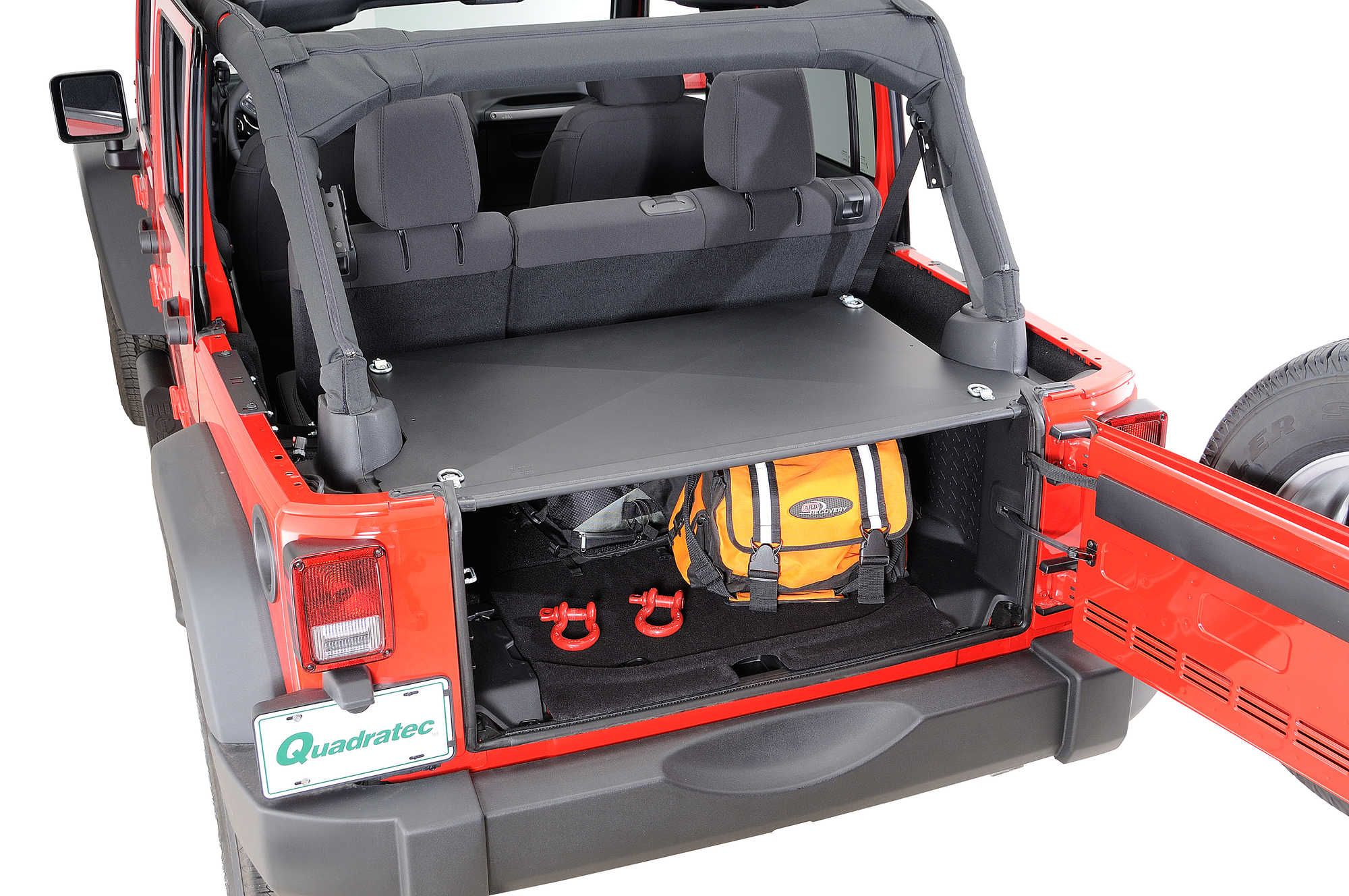 This new tailgate security enclosure works in the 4-door JK model with the rear seat. It operates in conjunction with the vehicle's tailgate to create a lockable trunk with over 22,000 cubic inches of storage.
