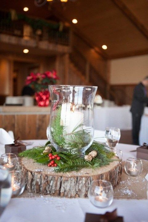 Rustic winter candle with tree stump wedding centerpiece
