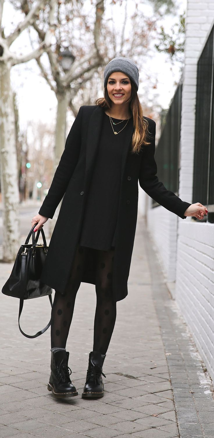 Winter Outfits Wed Wear Natalia Cabezas is wearing a black dress and coat from Zara boots from Dr Martens bag from Michael Kors and the hat is from Asos