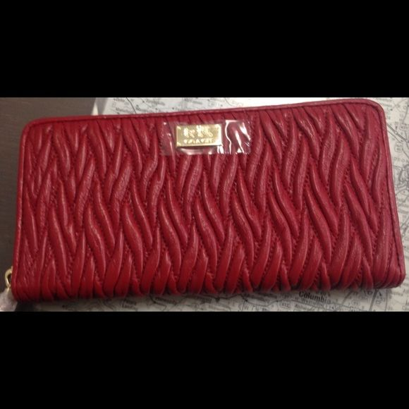 Coach Classic red mad twist wallet Super cute wallet with4 compartments and a change compartment. Coach Bags Wallets