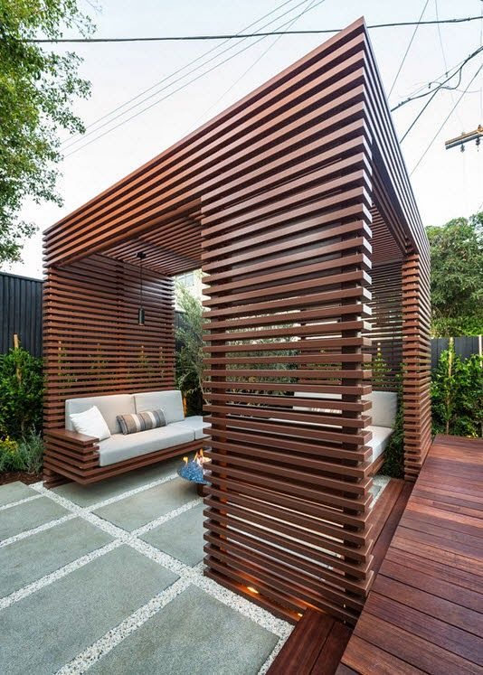 Dise o de una moderna terraza de madera de una casa en la for Terrazas modernas fotos