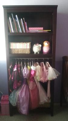 Diy Dress Up Organizer Using A Book Shelf And Adding Tension Rod For The Hanging Costumes Featured On Home Storage Solutions 101