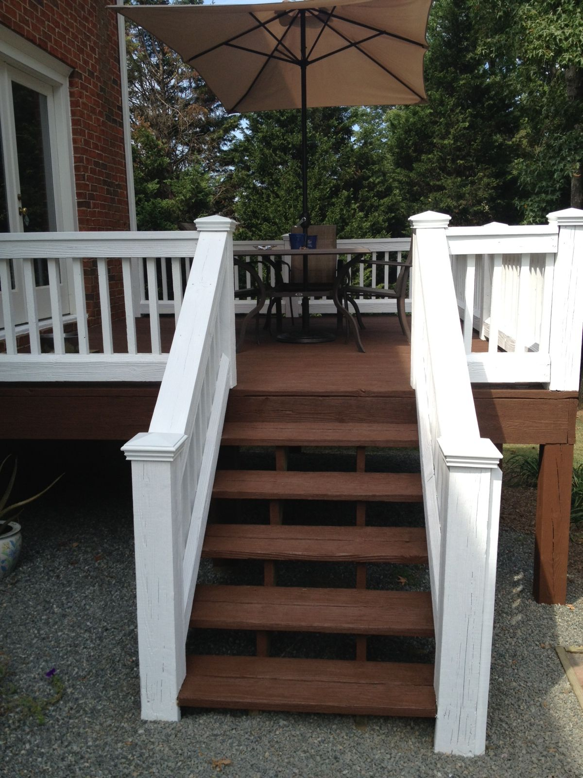 Deck after pressure wash and staining by fox brothers