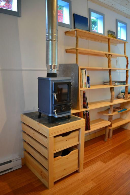 Woodstove on storage box ~ Hornby Island Caravans Tiny House on trailer - Small Multi Fuel Wood Burning Stove The Hobbit Boat Home Cabin