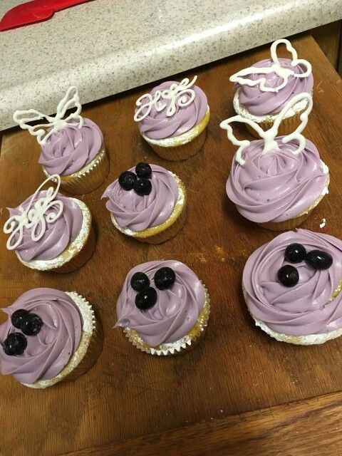 Lemon cupcake with blueberry frosting and chocolate decor