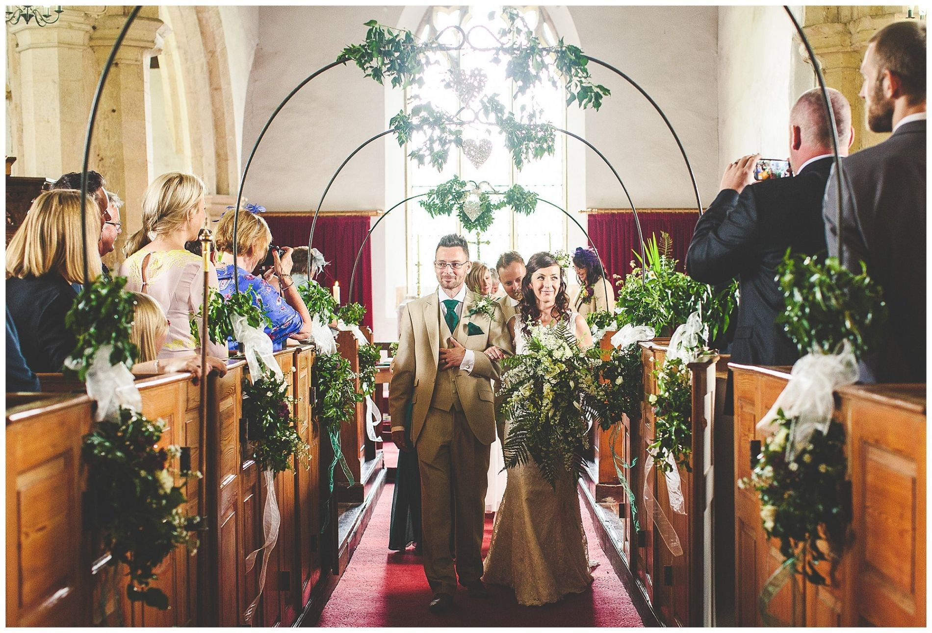 Wedding decorations inside church  Bringing the outdoors inside  rustic flowers and plants in church