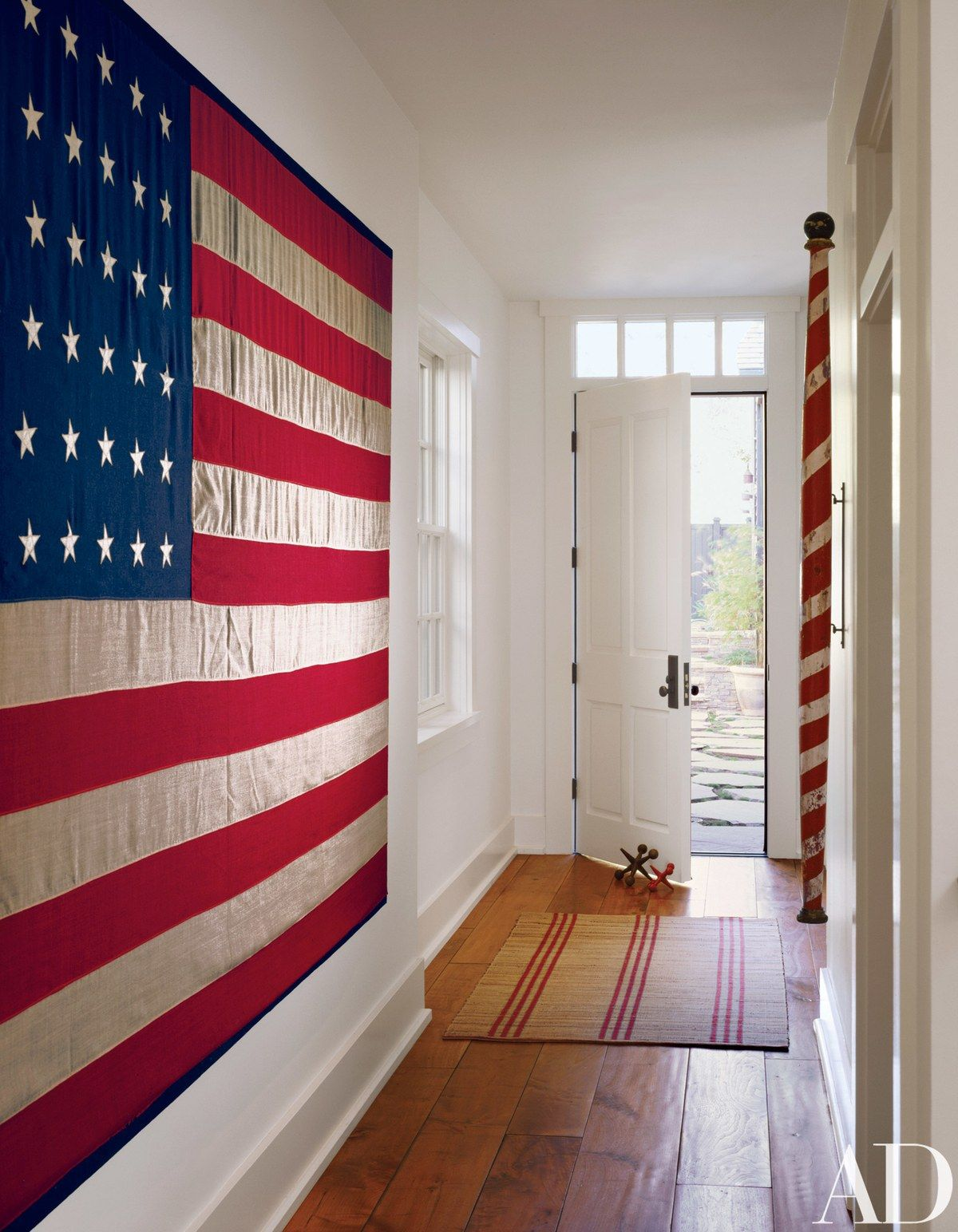 A vintage flag with 48 stars hangs on a wall in the entrance hall ...
