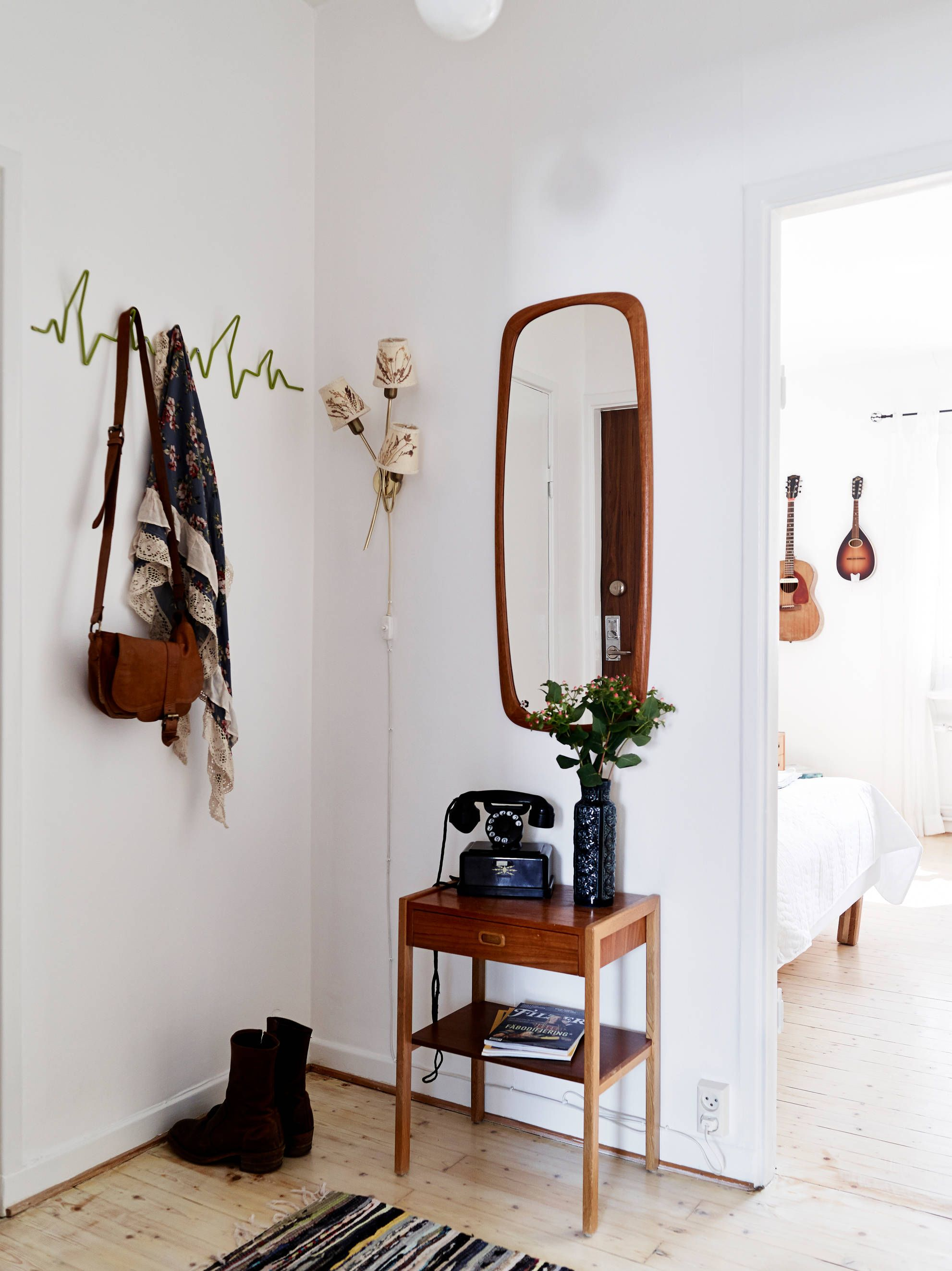 charming cabin coat rack. lovely entry space  white wooden side table mirror home decor sfgirlbybay House Tour An Eclectic Mix of Vintage Furniture in a Paris Loft