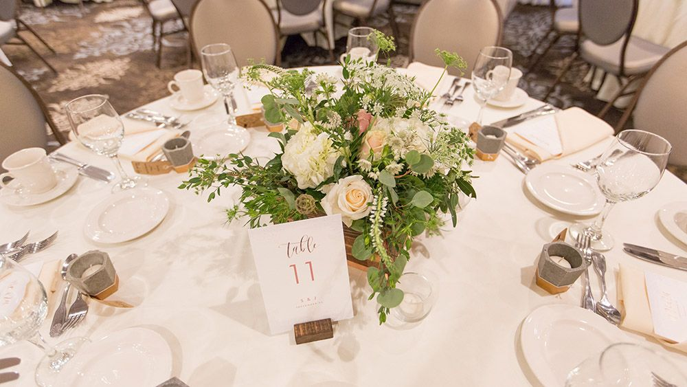 Organic and rustic wedding centerpiece at the Woodcliff Hotel. #stacykfloral #weddingcenterpiece #weddingtable