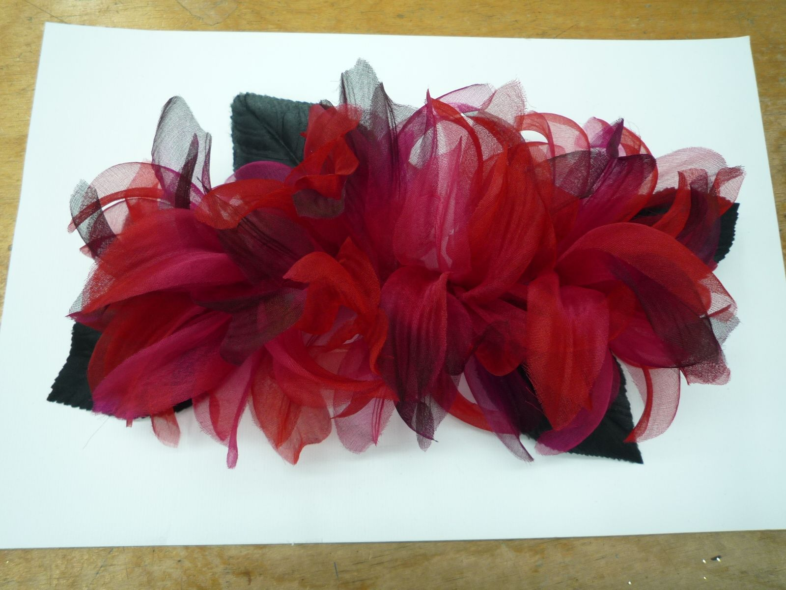 We had some loose petals laying around so we made this Gorgeous Cluster!  .... Just another day at the office!  See more @ www.customfabricflowers.com or come visit us on 36th street in NYC today!