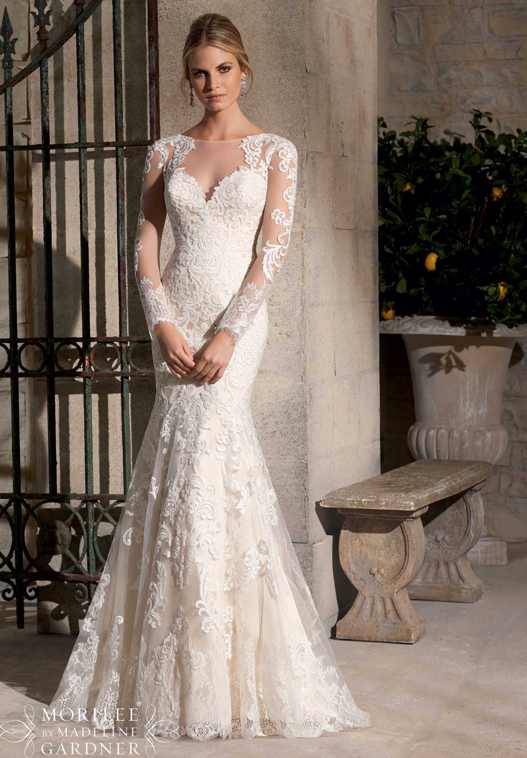 Come in to see this beautiful Mori Lee gown.  Wedding Dresses and Wedding Gowns by Morilee featuring Majestic Embroidered Appliques Combined with Chantilly Lace on Net with Wide Hemline