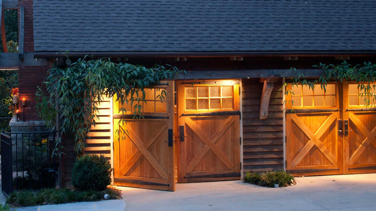 Garage door swing hinges - Swing Perfect Find A Charming Garage Door Southern Living From The Natural Wood