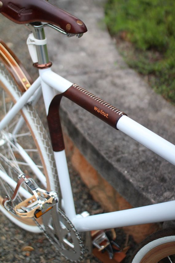 a comfortable stylish and sturdy leather strap for portaging your bicycle on your shoulder