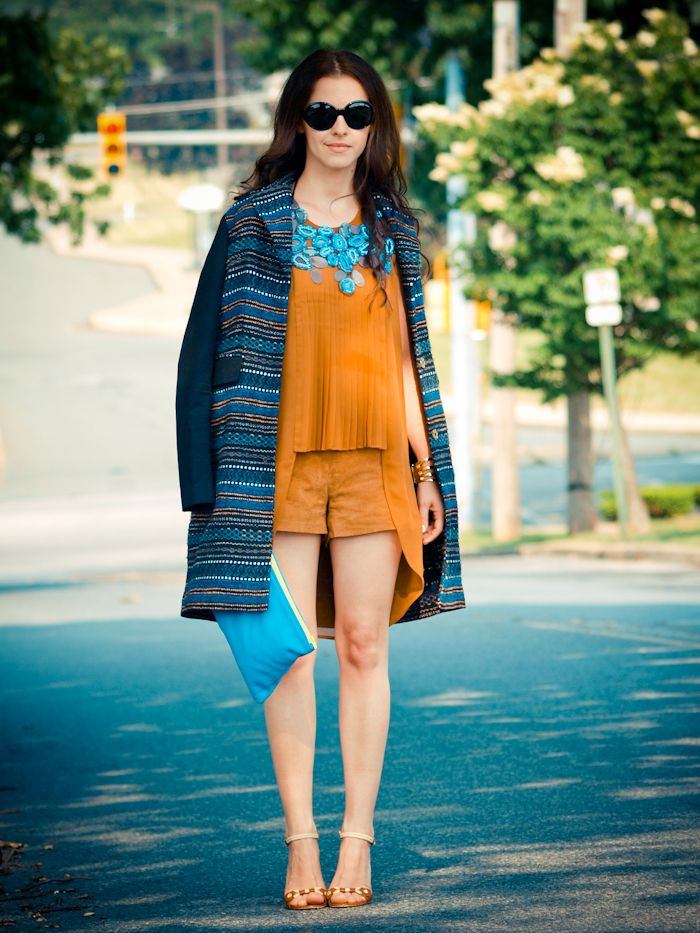 orange 2017 outfit with blue coat and clutch