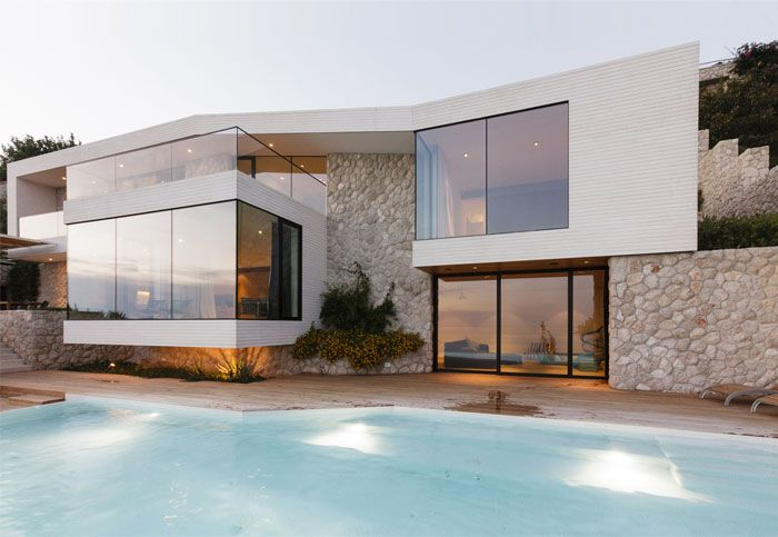 Mediterranean House With Large Glass Windows