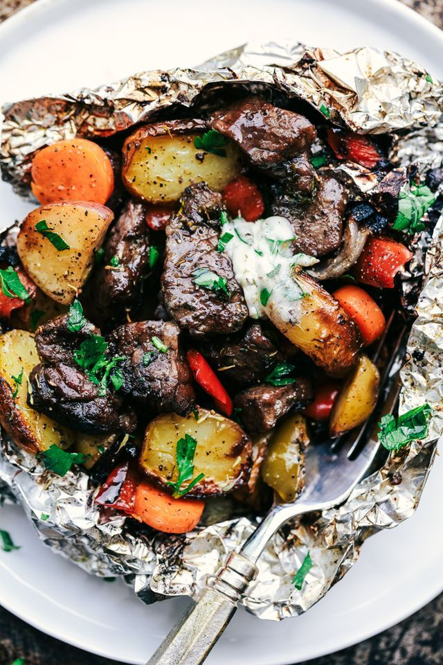 Butter Garlic Herb Steak Foil Packets have melt in your mouth beef with hearty veggies that are grilled to perfection with butter that has garlic and herbs inside. This is one amazing meal that you do