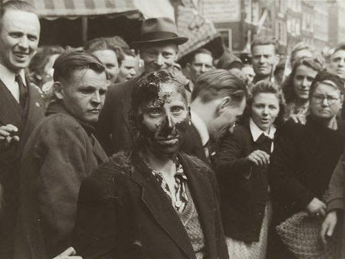 World War II. Collaboration. Shaving and tarring [pitch] of ['Moffenhoeren-Kraut whores'] after the liberation of Holland. Amsterdam, The Netherlands, May, 1945.