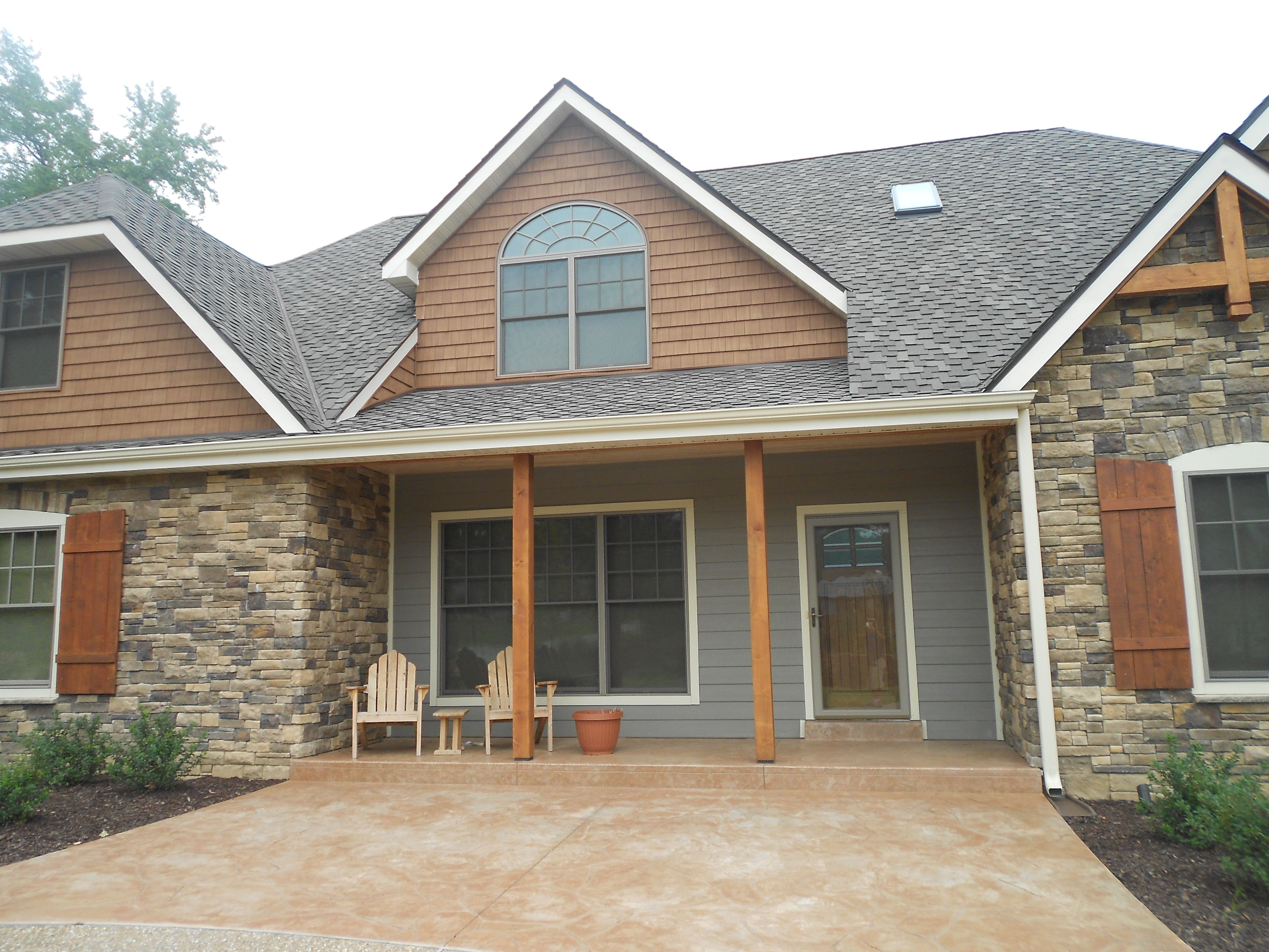 Front Of The House With Cedar Impressions Shingles On Gables Brick Exterior House Brick Siding House Exterior