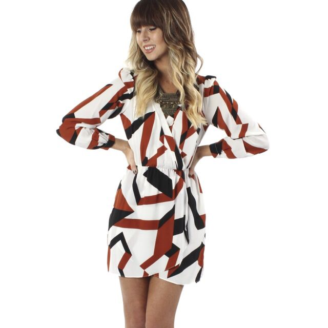 """From work to play, you will be looking fierce in the new """"geo wrap dress""""! Shop it now online and in store at #tria for only $39.99! www.sophieandtrey.com #wrapdress #newarrivals #sophieandtrey #freeshipping"""