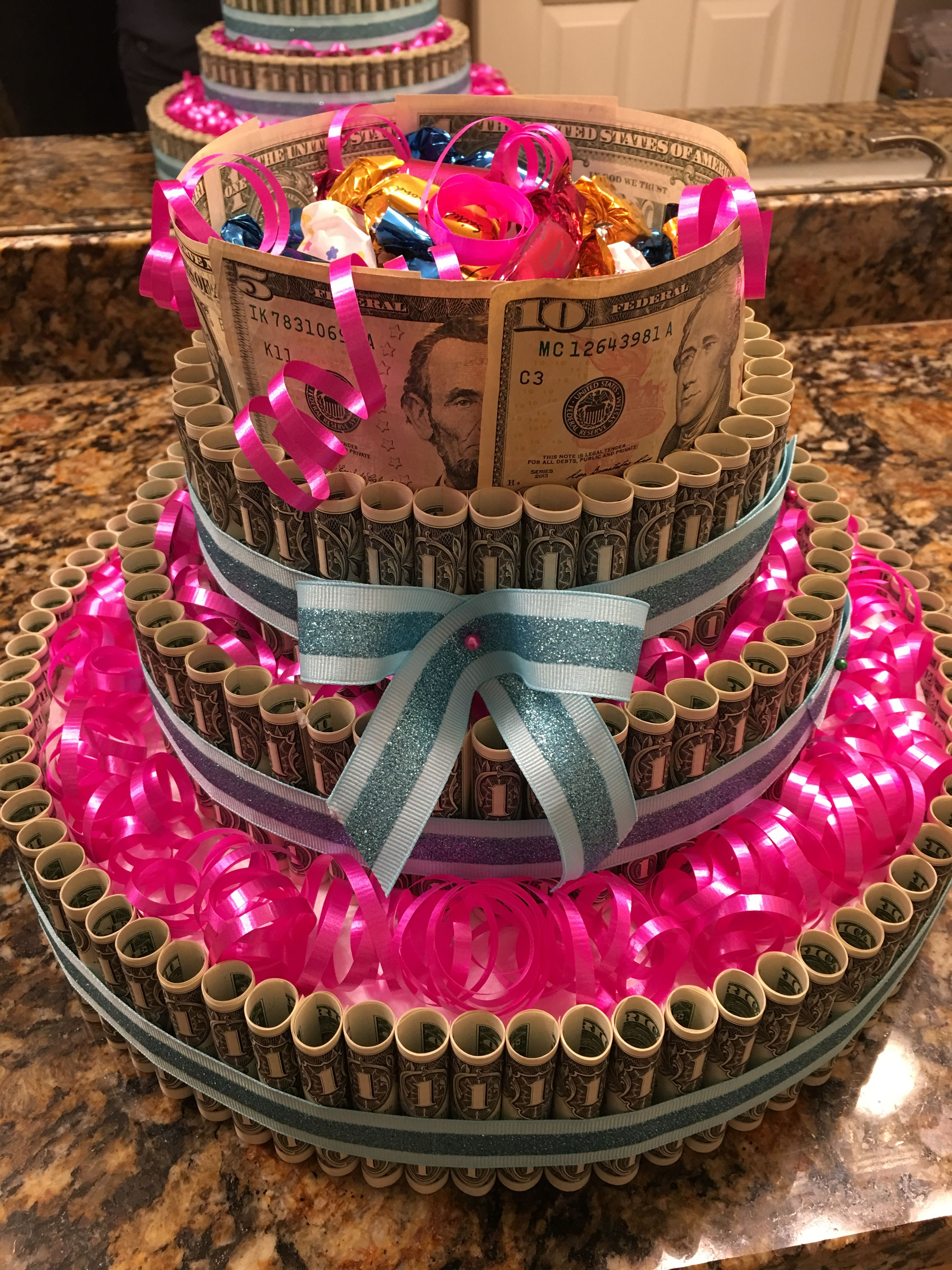 Money cake out of dollar bills for daughters 18th birthday