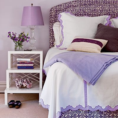 Lavender is known to be a calming shade, and Amanda used it to good effect in the master bedroom. Pale lavender appears in the lamp shade and sheet set, while a deeper amethyst hue adds kick to the bed upholstery and accent pillows.