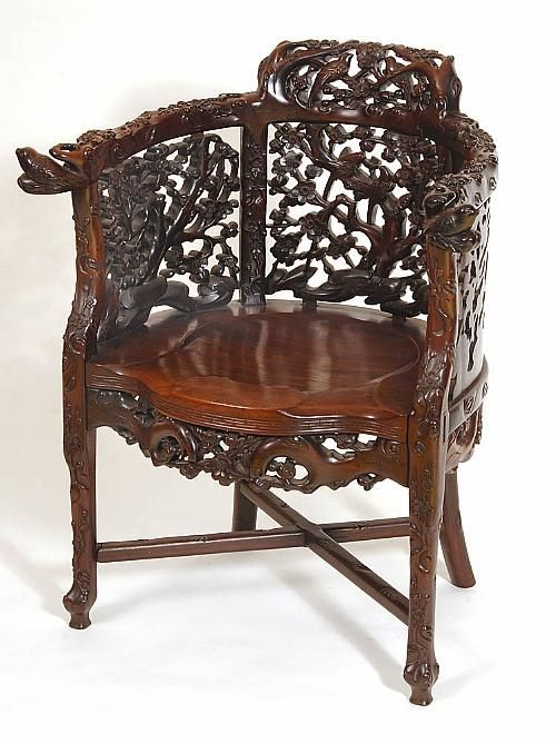 A Chinese Rosewood Chair Elaborately Carved With Birds Amongst