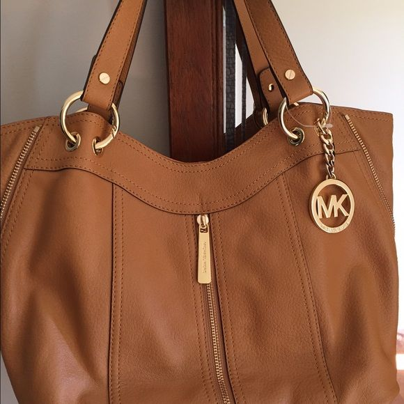 7d5364f458dc Authentic Michael Kors Moxley tote NWOT camel/ peanut color with one front  zipper and two side zippers. Gold tone hardware. Soft buttery leather with  MK ...
