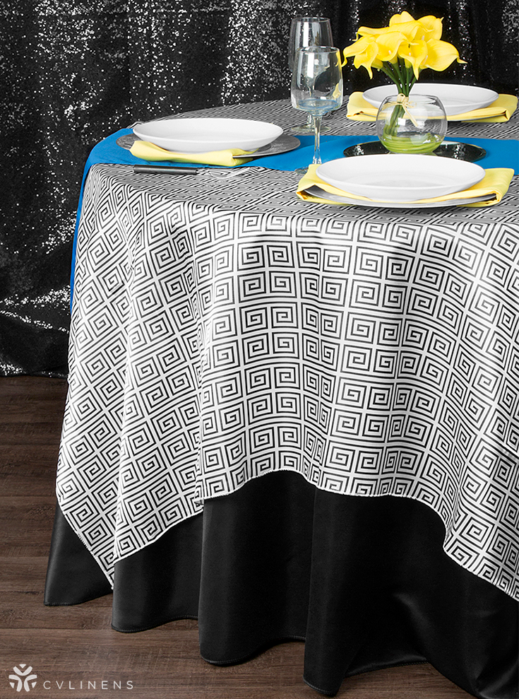 Bold Black & White, Canary Yellow, and Royal Blue Tablescape. The Greek Key pattern has a proposed meaning of love and friendship, what better pattern can you find for a wedding or anniversary party?