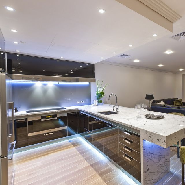 12 bright and elegant kitchen designs from mal corboy luxury modern kitchen design with glossy kitchen cabinet and marble kitchen countertop