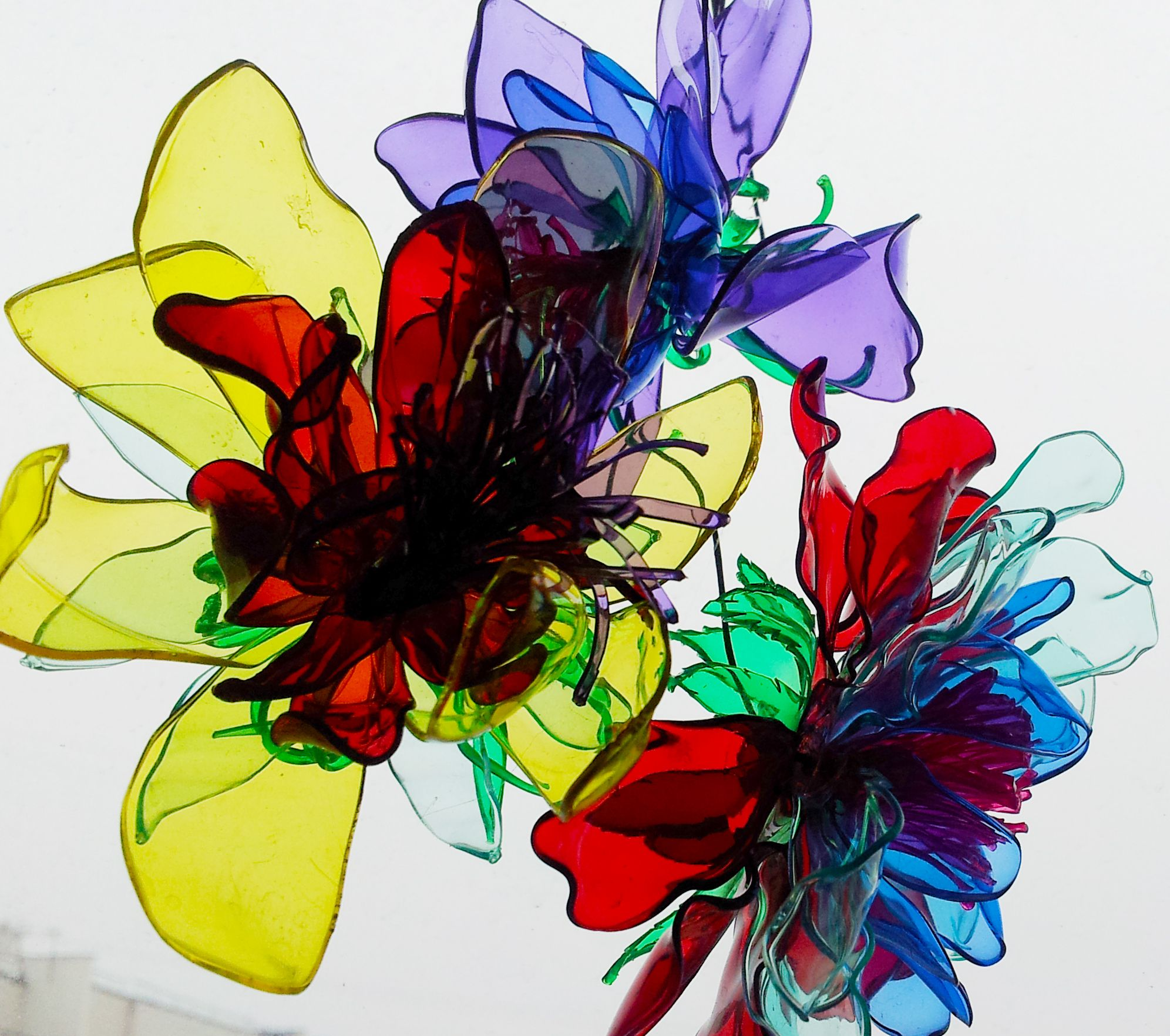 Recycled plastic bottle flowers plastic flowers for Recycled flower art