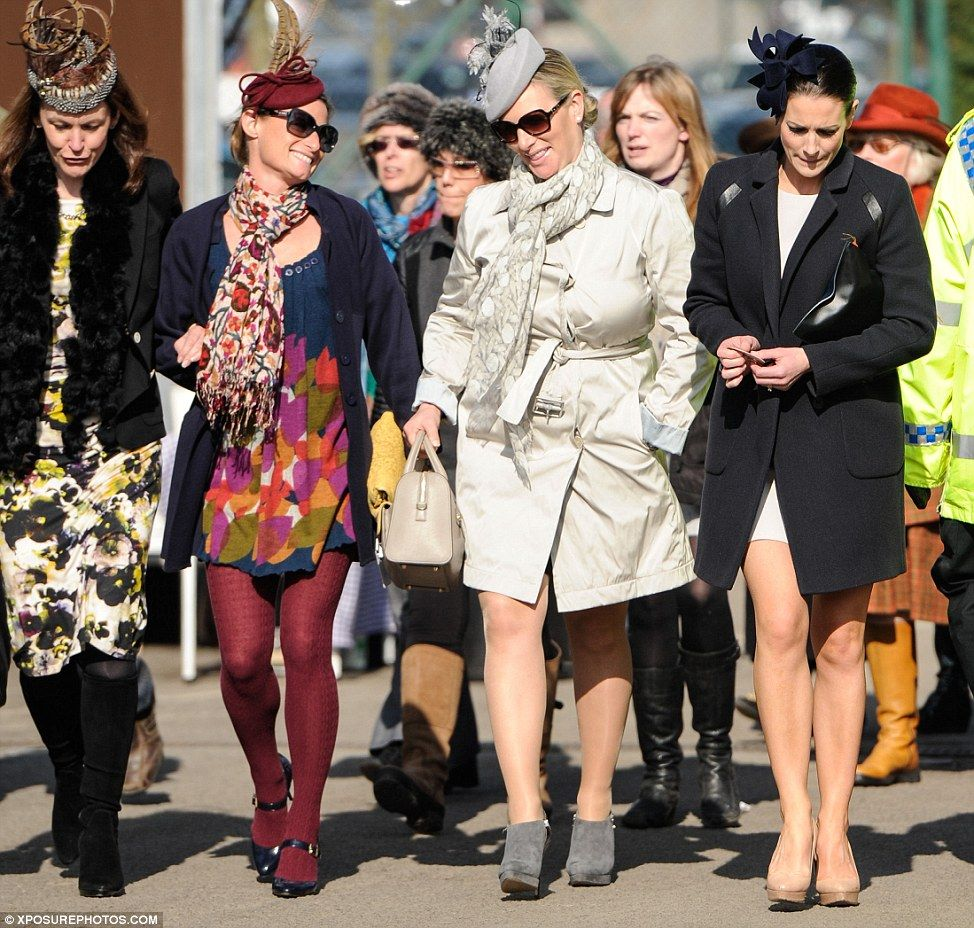 Zara Phillips is elegant in a grey trench and fascinator ...