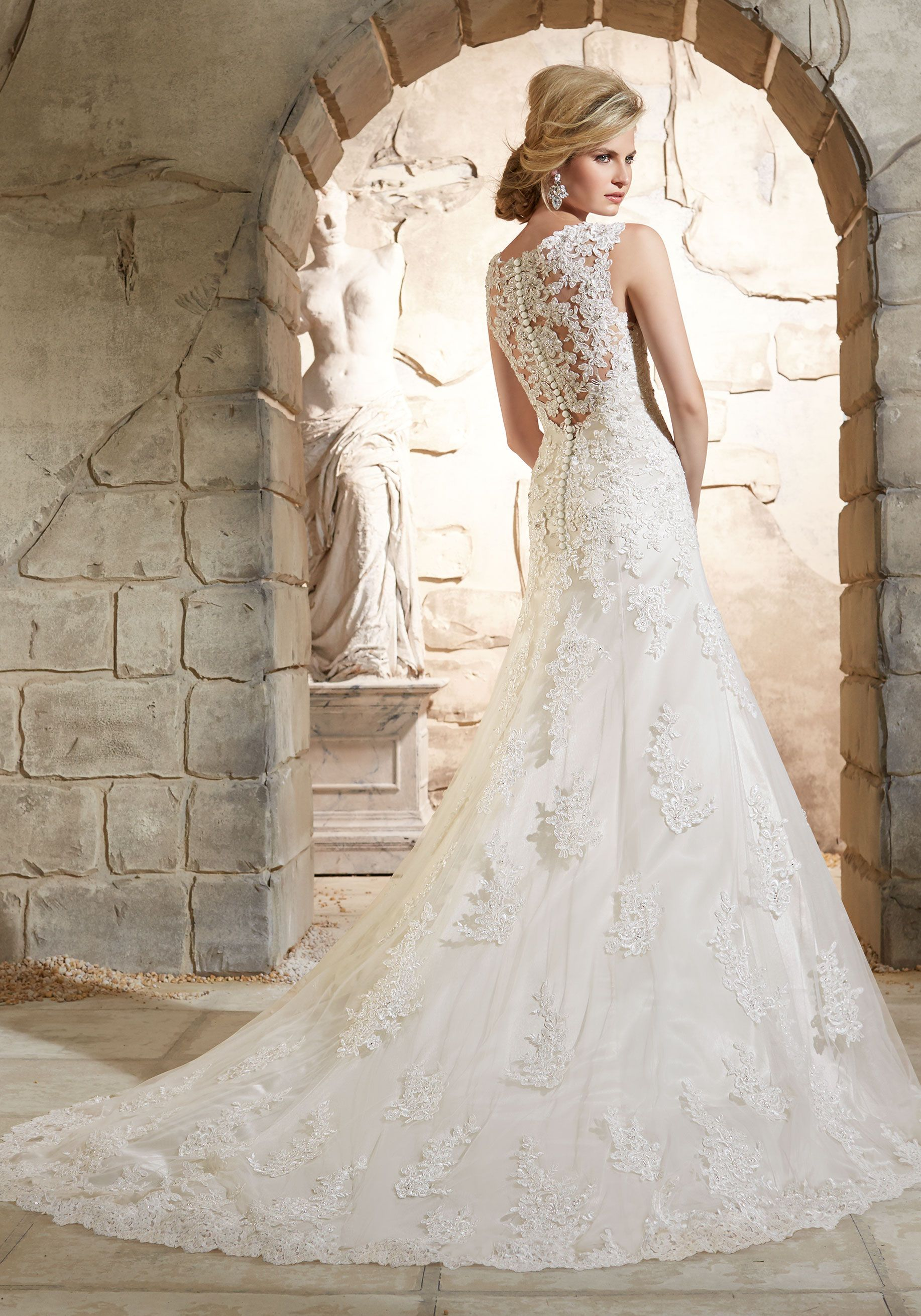 This Lace Bridal Dress features a scalloped hemline, and stunning ...