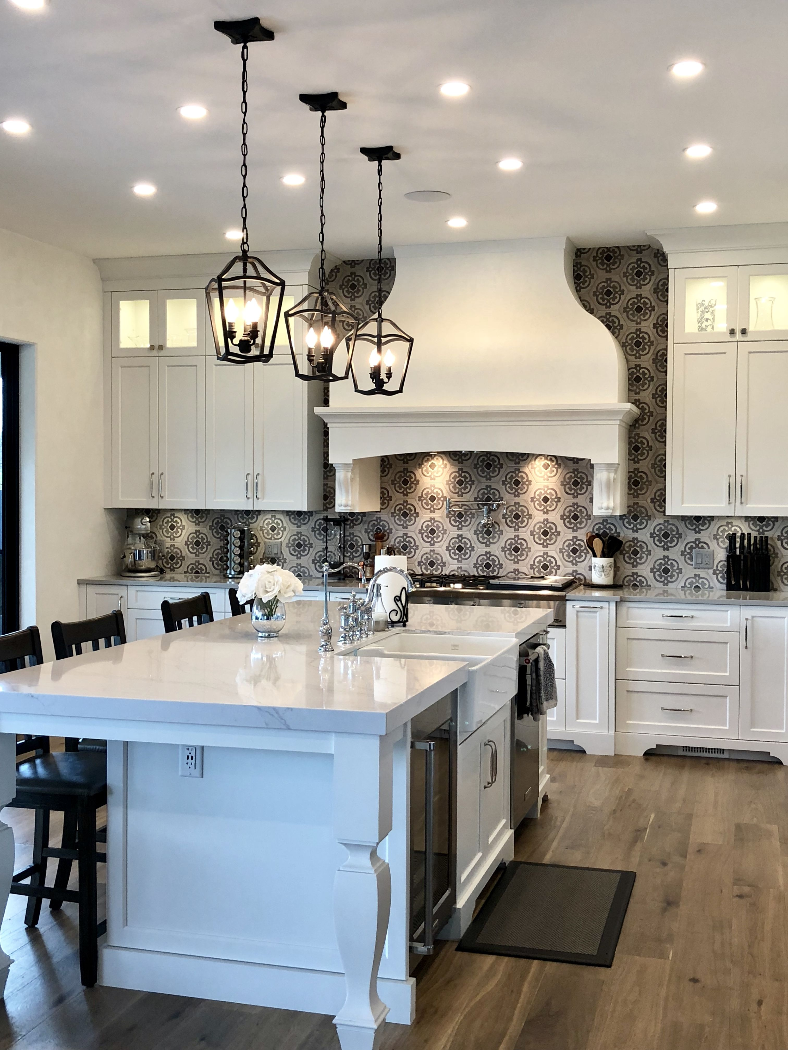 White kitchen with patterned cement tile backsplash ...