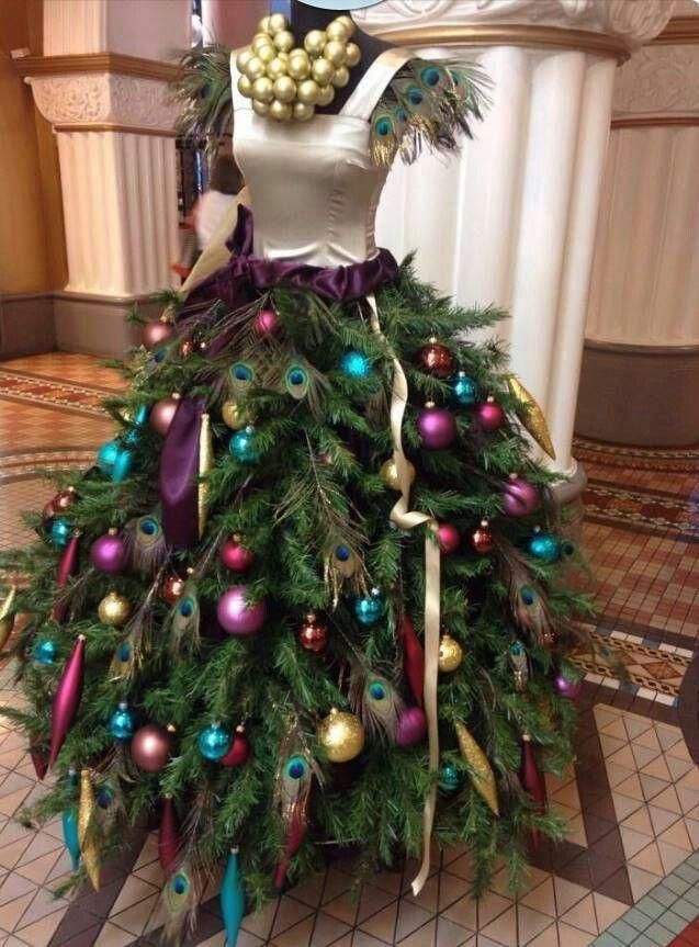 This Mannequin Gives Way To A Couture Chrstmas Tree Simply Layer Pine Branches Around The Dress Form Christmas Tree Mannequin Christmas Tree Xmas Decorations