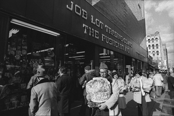 Shoppers leaving Job Lot Trading at Church and Chambers Streets, 11/1976