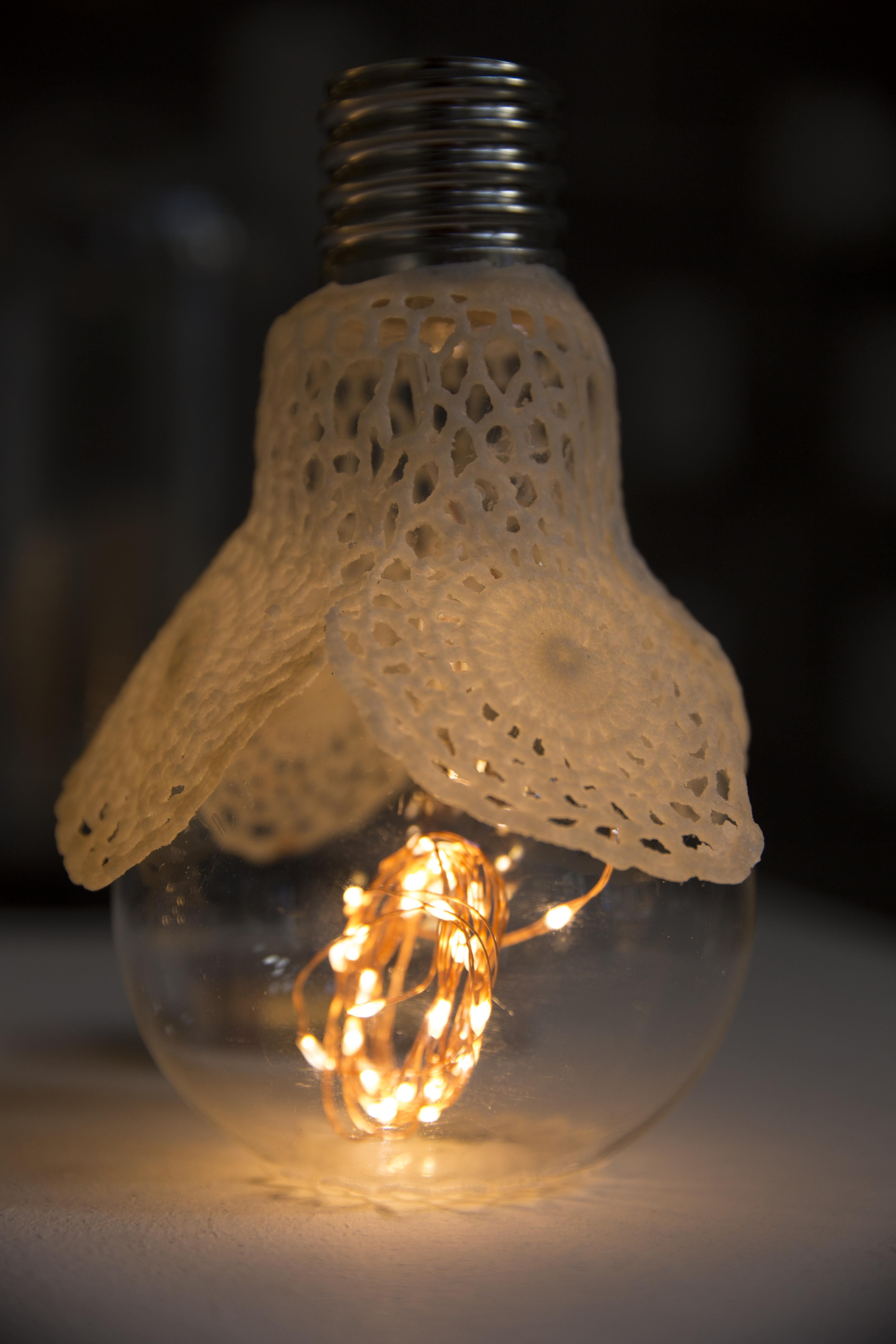 Old light bulbs, waxed fabric and LED light Arch light