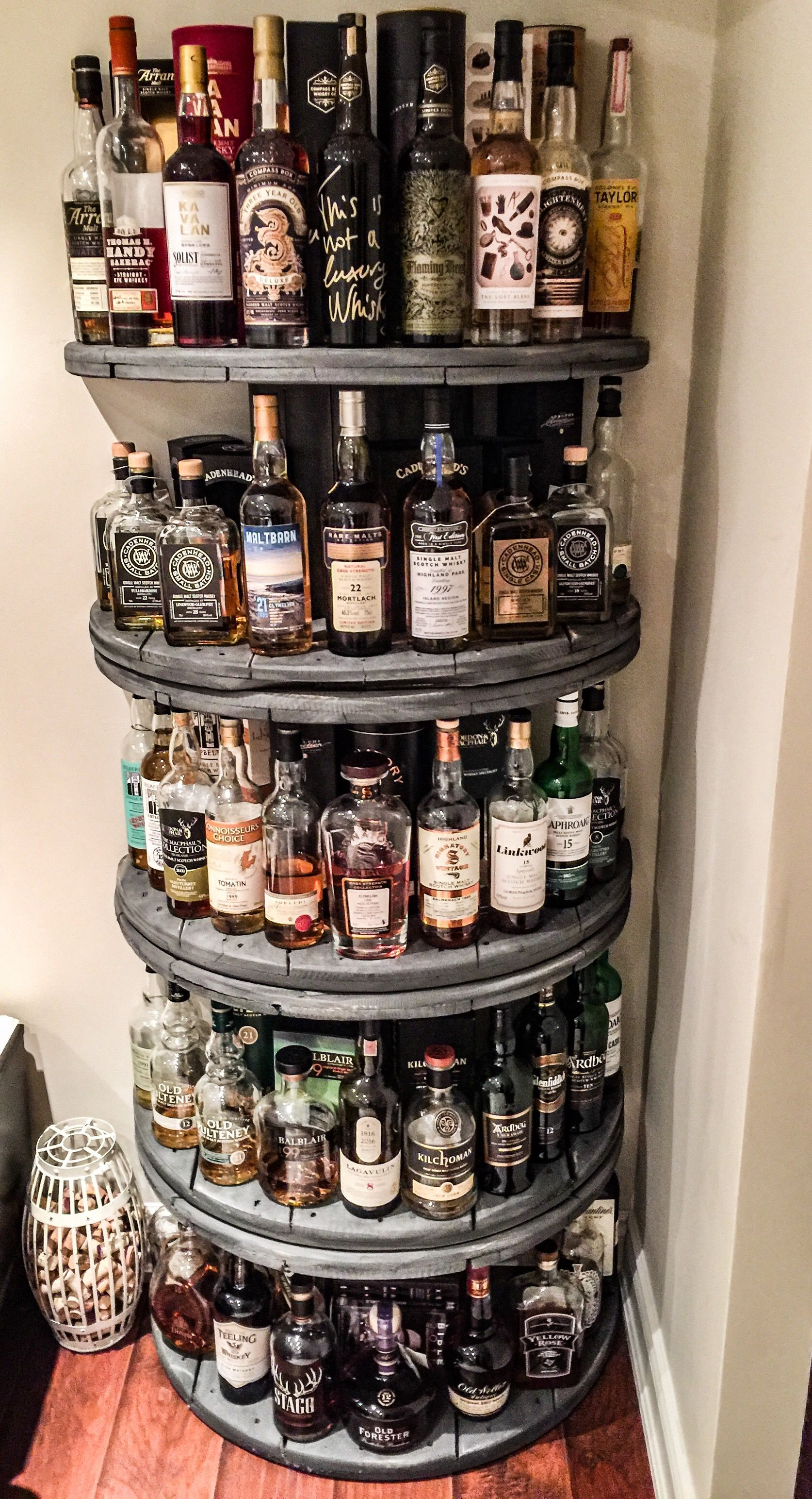whisky shelf made from old wooden wire spools diy basement pinterest wire spool shelves. Black Bedroom Furniture Sets. Home Design Ideas