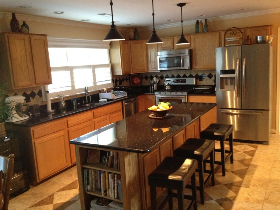 oak kitchen cabinets black counter images | Granite ... on What Color Granite Goes With Honey Maple Cabinets  id=46218