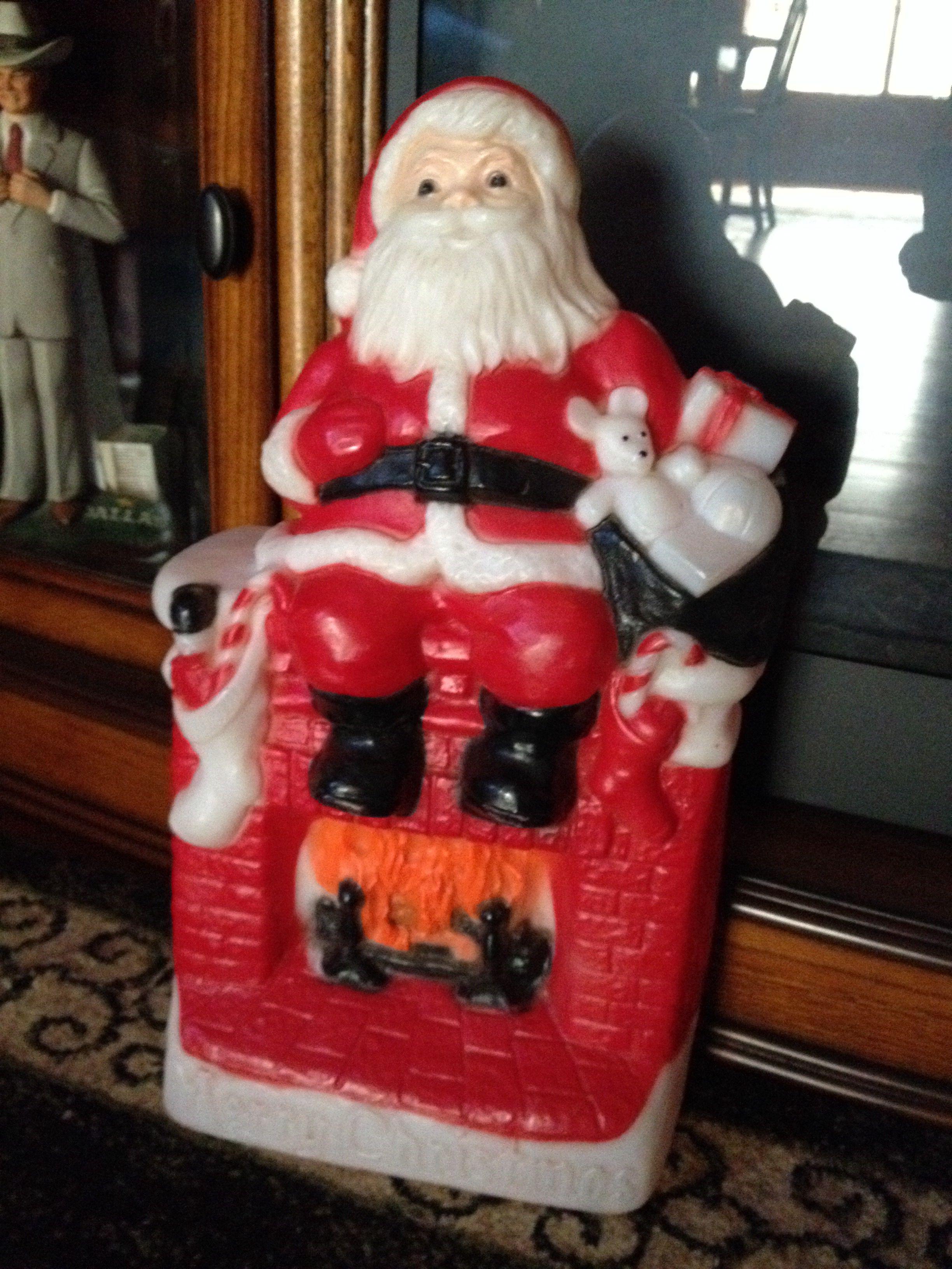 1981 Santa setting on fireplace blow mold